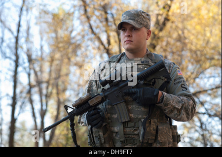 Senior Airman Jordan Nett, 376th Expeditionary Security Forces Squadron response force leader, patrols Frunze Forest - Stock Photo