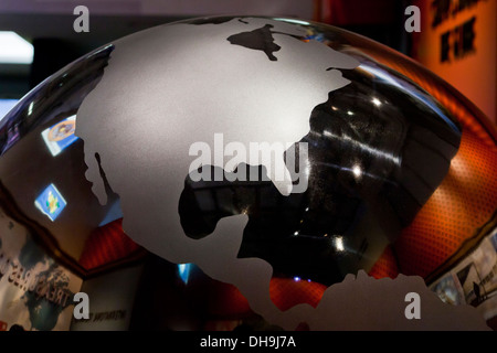 Stainless steel globe showing North American continent - Stock Photo