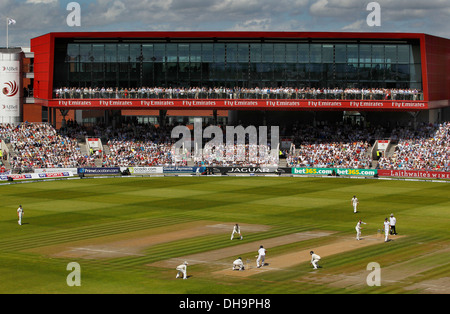 Action during the England vs Australia Ashes Test at Old Trafford Cricket Ground with the stand 'The Point' in the - Stock Photo