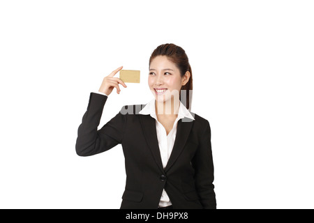 Businesswoman holding credit card - Stock Photo