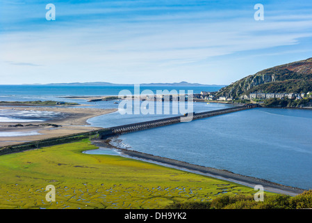 A panoramic view with a Cambrian coast train crossing crossing Barmouth bridge plus Barmouth, Cardigan bay and Lleyn - Stock Photo