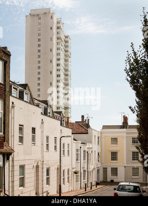 Sussex Heights is a residential tower in Brighton. In the foreground typical terraced homes of Brighton on the border - Stock Photo