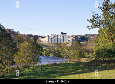 The river Aln passing Alnwick castle, Northumberland, England, UK - Stock Photo
