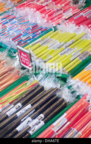 Sticks of rock candy for sale in Whitby, North Yorkshire, England - Stock Photo