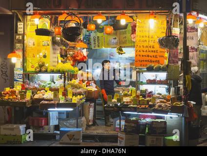 Greengrocer's Shop At Night; Hong Kong, China - Stock Photo