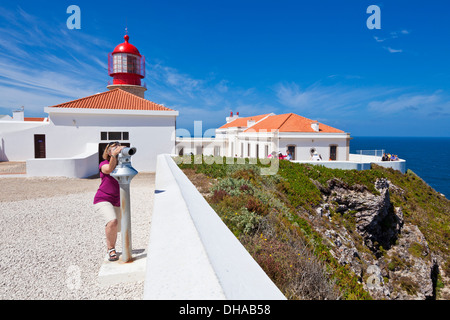 Person looking at the view through a telescope at the Lighthouse at Cape St Vincent Sagres Algarve Portugal EU Europe - Stock Photo