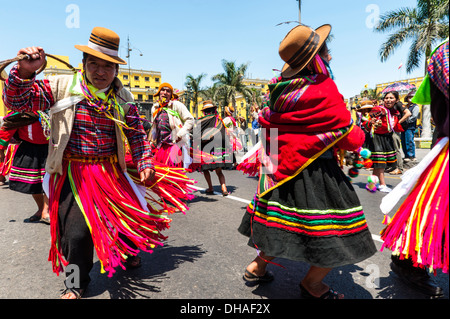 Indians in traditional peruvian dresses dancing in the square Plaza de Armas, Lima, Peru - Stock Photo