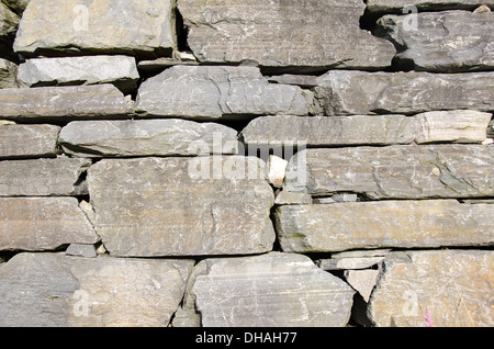pattern gray color of modern style design decorative uneven cracked real stone wall surface - Stock Photo