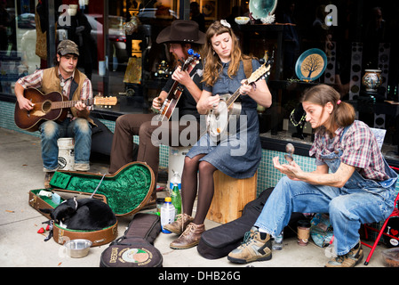 Street musicians in Asheville North Carolina, Abby the Spoon Lady, Wyatt Yurth & Nora Jean and Lil' Maxwell - Stock Photo