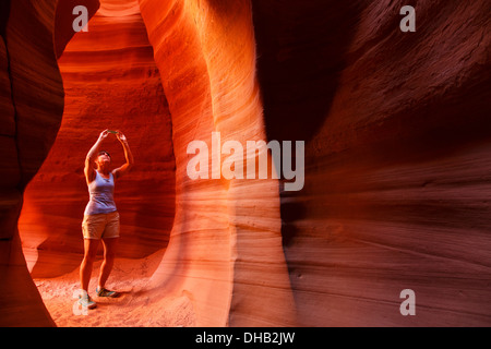 A visitor in Canyon X slot canyon, Page, Arizona. (model released)  - Stock Photo