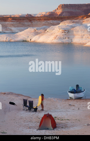 Boat camping in West Canyon, Lake Powell, Glen Canyon National Recreation Area, Page, Arizona. - Stock Photo