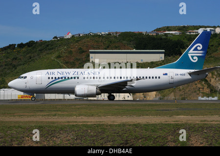 Air New Zealand aircraft waiting on runway ready for take-off - Stock Photo