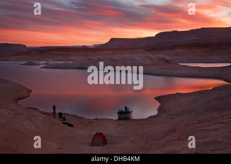 Camping in West Canyon at sunrise, Lake Powell, Glen Canyon National Recreation Area, Page, Arizona. - Stock Photo