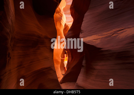 A visitor in the slot canyon known as Secret Canyon on Navajo land, Page, Arizona. (model released) - Stock Photo
