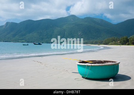 A view of a turquoise, circular rowboat on An Hai Beach on Con Son Island, one of the Con Dao Islands in Vietnam. - Stock Photo