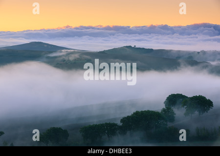 Sunrise in the Tuscany, near San Quirico in de Val d'Orcia valley - Stock Photo