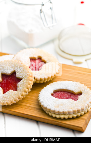 jelly christmas cookies on wooden kitchen board - Stock Photo