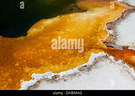 Detail of colourful water mineral deposits and rock formations from Midway Geyser, in Yellowstone National Park. - Stock Photo