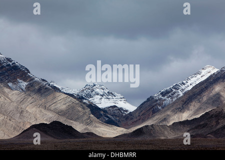 Snow covered mountains and ominous sky, Panamint Mountains, Death Valley NP - Stock Photo