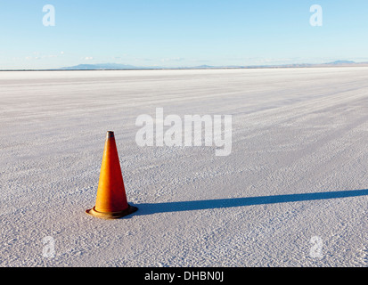 A single traffic cone in the white landscape of the Bonneville Salt Flats, during Speed Week - Stock Photo