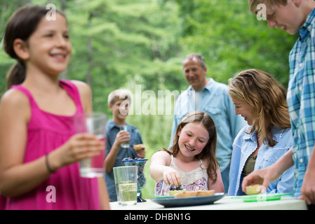 Organic Farm. An outdoor family party and picnic. Adults and children. - Stock Photo
