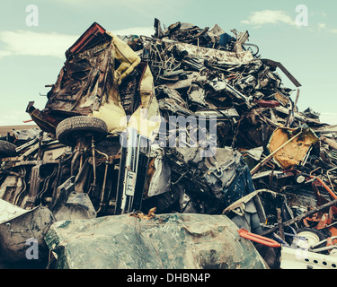A heap of twisted metal, a scrap metal yard, a collection of objects for recycling. - Stock Photo