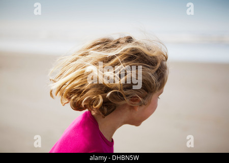 View of from behind of six year old girl on beach, Long Beach Peninsula - Stock Photo