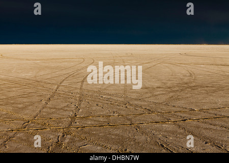 Tire tracks on the Bonneville Salt Flats. Speed Week. A dark stormy sky. - Stock Photo