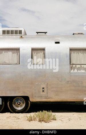 A vintage Airstream silver accommodation trailer parked on the Bonneville Salt Flats during Speed week. - Stock Photo