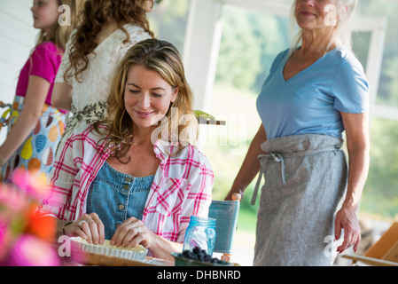 A family party in a farmhouse in the country in New York State. Adults and children. - Stock Photo