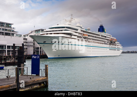 Cruise Ship Docked In The Auckland Harbor Called The Viaduct; Auckland, New Zealand - Stock Photo