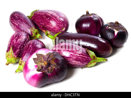Different varieties of eggplant with water drops isolated on white background. Top view. - Stock Photo