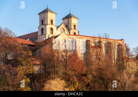 Benedictine monastery and Saint Peter and Paul church in Tyniec near Cracow, Poland, in fall at sunset - Stock Photo