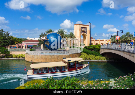 Boat on  lake in front of Globe at t entrance to Universal Studios, Universal Orlando Resort, Orlando, Central Florida, - Stock Photo