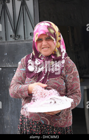 Traditional lady in Cappadocia, Turkey - Stock Photo