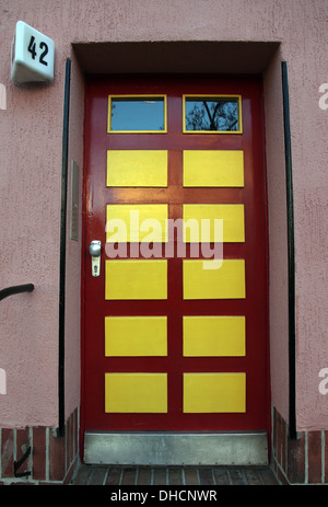 Front door of apartment block in the 1925 Horseshoe Housing Estate in Berlin, designed by Bruno Taut - Stock Photo
