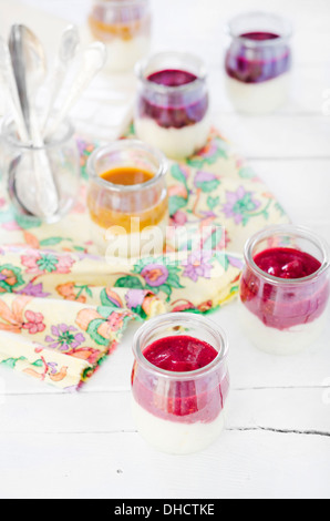 Different semolina porridge in glasses - Stock Photo