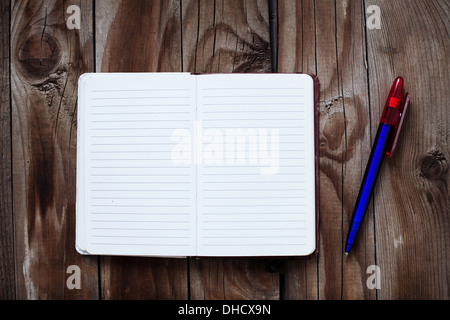 Blank notepad on old wooden table with pen - Stock Photo