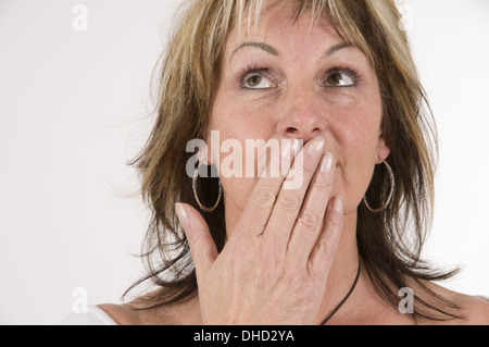 mature woman say nothing - Stock Photo