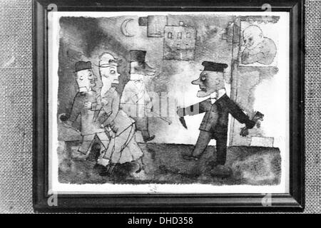 A National Socialist propaganda picture shows a painting by George Grosz at the Degenerate Art Exhibition in Dresden, - Stock Photo