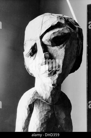A National Socialist propaganda picture shows a wooden sculpture by Erich Heckel at the Degenerate Art Exhibition - Stock Photo