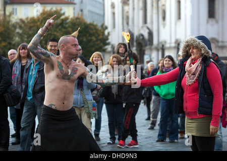 Performer on the street showing his art for people and entertain the audience Prague Old Town Square Czech Republic, - Stock Photo