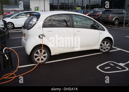 Electric car charging point in a supermarket car park - Stock Photo