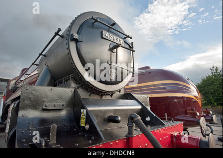 An LMS (London Midland Scottish) Julbilee class steam locomotive 45699, 'GALATEA' stands in front of Streamlined - Stock Photo