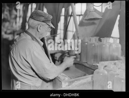 Millville, New Jersey - Glass bottles. Stopper-grinder at T. C. Wheaton Co 518634 - Stock Photo