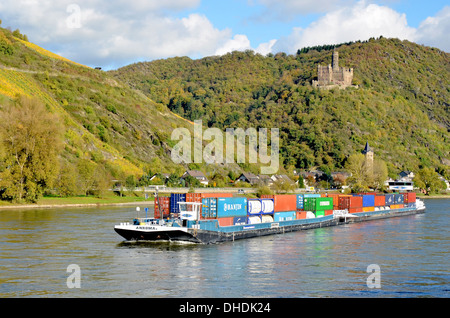 Maus Castle (German: Burg Maus) is a castle above the village of Wellmich on the River Rhine, Germany, a cargo boat - Stock Photo