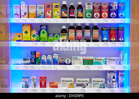 Cold flu remedies and  medicine pictured on a pharmacy shelf - Stock Photo