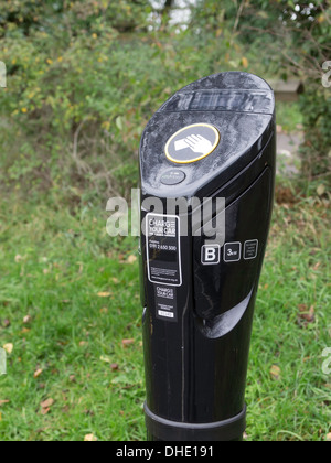 Electric Car Charging Point in a car park in a woodland recreation area - Stock Photo