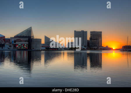 The rising sun brings a new day to the waters of the Patapsco River and the Inner Harbor in Baltimore, Maryland. - Stock Photo