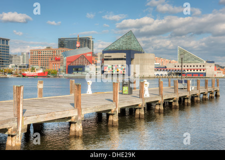 A view of the National Aquarium, Baltimore under a partly cloudy sky in Baltimore, Maryland. - Stock Photo